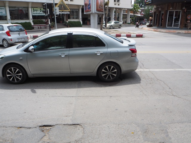 Unevenness in roads in Thailand can cause you to get off balance